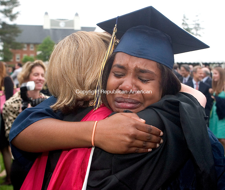 CHESHIRE, CT -31 MAY 2008 -053108DA08- Faith Phinn sheds tears saying goodbye to her spanish teacher and dorm room parent Julie Denomme after the commencement for the Cheshire Academy graduating class of 2008 at the school in Cheshire Saturday.<br /> Darlene Douty/Republican-American