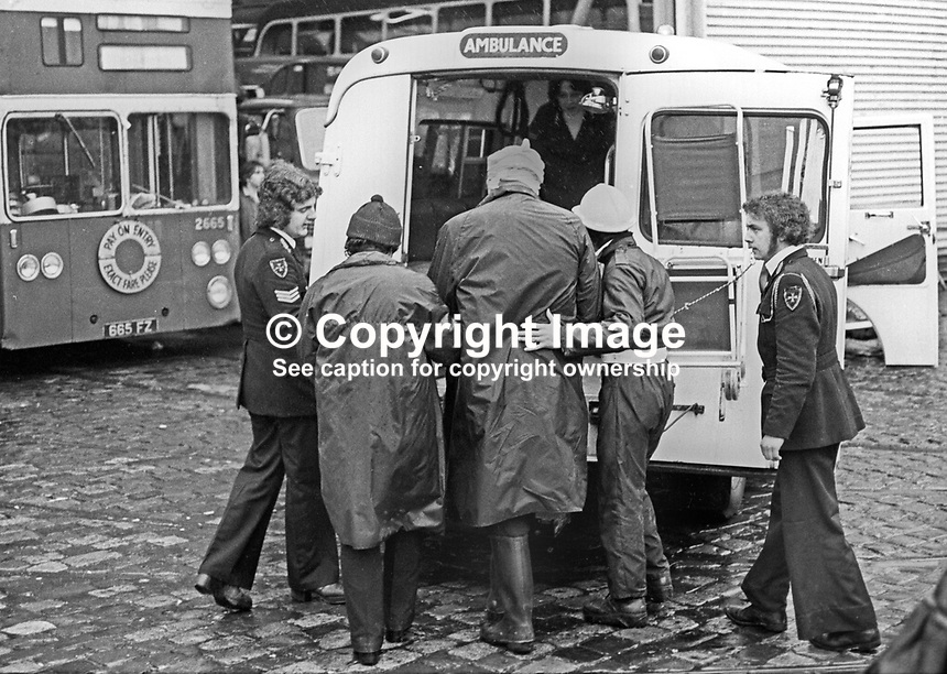 Peace People March along the Falls Road, Belfast, N Ireland, UK, 23rd October 1976 - Canon Padraig Murphy, Roman Catholic priest, St John's, Falls Road, is assisted to an ambulance after being hit by a missile thrown by an opponent of the Peace March. 197610230506b <br />
