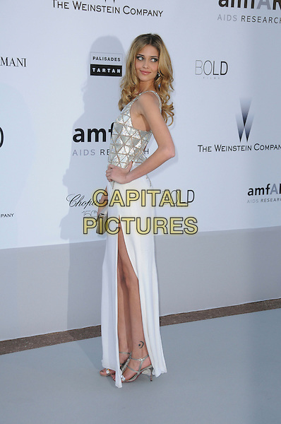 ANA BEATRIZ BARROS.arrivals at amfAR's Cinema Against AIDS 2010 benefit gala at the Hotel du Cap, Antibes, Cannes, France during the Cannes Film Festival.20th May 2010.amfAR full length white dress hand on hip silver side sleeveless slit split .CAP/CAS.©Bob Cass/Capital Pictures.