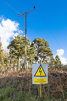 On farm warning sign - caution overhaed power cables