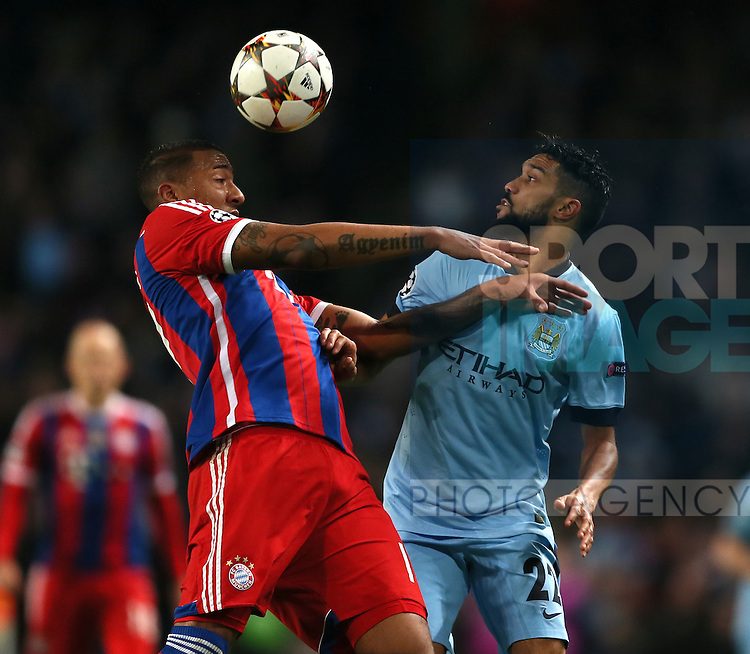 Jerome Boateng of Bayern Munich tussles with Gael Clichy of Manchester City - UEFA Champions League group E - Manchester City vs Bayern Munich - Etihad Stadium - Manchester - England - 25rd November 2014  - Picture Simon Bellis/Sportimage