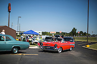 A 1957 Chevrolet Bel Air Convertible registered to John Neiding Jr., center, is among cars in line for tech check and classification during 4th State Representative Chevy Show on Thursday, June 30, 2016, in Fort Wayne, Indiana. (Photo by James Brosher)