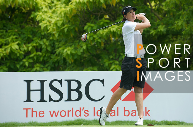 SINGAPORE - MARCH 08:  Juli Inkster of the USA tees of on the par four 6th hole during the final round of HSBC Women's Champions at the Tanah Merah Country Club on March 8, 2009 in Singapore. Photo by Victor Fraile / The Power of Sport Images