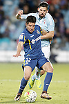 Getafe's Emi Buendia (l) and Celta de Vigo's Nolito during La Liga match. February 27,2016. (ALTERPHOTOS/Acero)