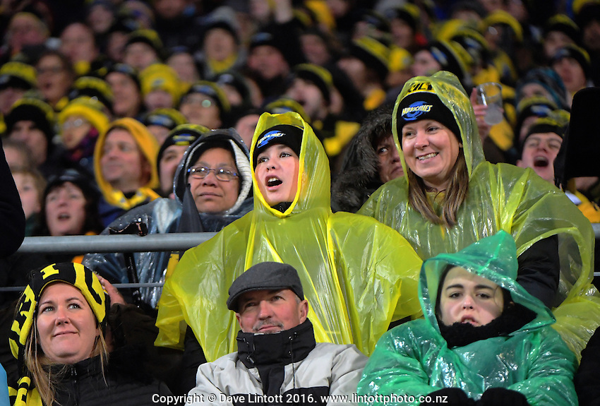 Fans in the grandstand during the Super Rugby final match between the Hurricanes and Lions at Westpac Stadium, Wellington, New Zealand on Saturday, 6 August 2016. Photo: Dave Lintott / lintottphoto.co.nz