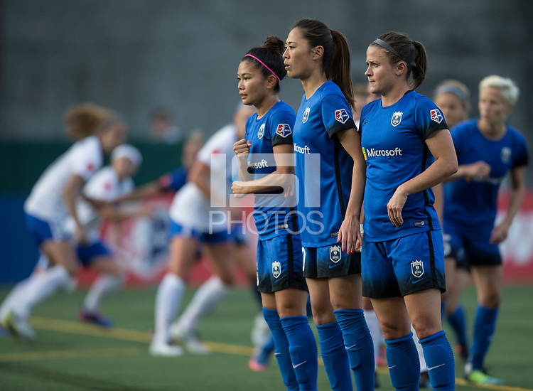 Seattle, WA - Saturday July 15, 2017: Nahomi Kawasumi, Rumi Utsugi, Christine Nairn during a regular season National Women's Soccer League (NWSL) match between the Seattle Reign FC and the Boston Breakers at Memorial Stadium.