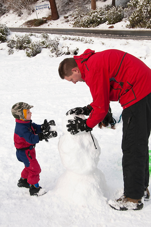 California, Lake Tahoe: Child makes a snow man at  North Lake Tahoe Regional Park.  Photo copyright Lee Foster.  Photo # cataho107557