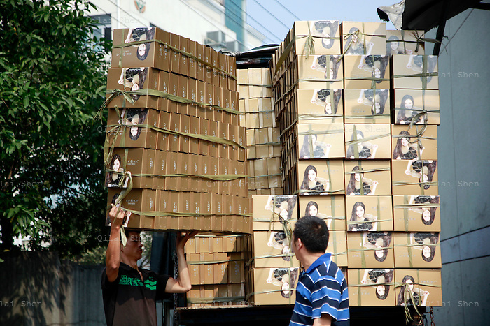 "Workers unload a truck stacked with boxes of shoes at a factory in an area known as ""Xie Du"", or shoe capital, in the city of Wenzhou, Zhejiang Province on 24 October, 2011. Wenzhou has seen a spate of business owners disappearing under the pressure of debt, as small and medium size businesses face increasing difficulties in securing loans, while the slow recovery of the European and U.S. economies continues to disappoint exporters."