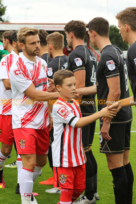 The Stevenage mascot shakes hands with the MK Dons players during Stevenage vs MK Dons, Friendly Match Football at the Lamex Stadium on 30th July 2016