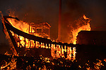 Donggang, Taiwan -- Searing flames devour the structure of the King Boat.