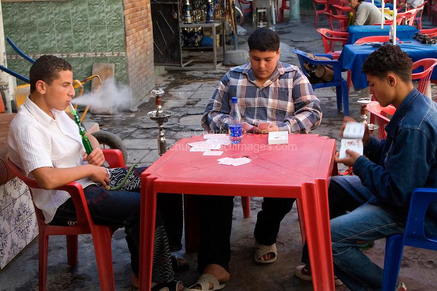 Tripoli, Libya - Young Men Playing Cards, Smoking Shisha, in Cafe, Tripoli Medina (Old City).