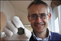 BNPS.co.uk (01202 558833)<br /> Pic: MaisieHill/BNPS<br /> <br /> David Tucker, director of Lyme Regis Museum with the Mary Anning token.<br /> <br /> A mysterious metal disc that belonged to famous fossil hunter Mary Anning as a child has been discovered on the very beach where she created the science of palaeontology over 200 years ago.<br /> <br /> The small token that bears her name and the year 1810 on one side and the words 'Lyme Regis Age XI' on the reverse was unearthed by metal detectorist Phil Goodwin in a remarkable find.<br /> <br /> Mr Goodwin, 69, was scouring the fossil-rich Dorset beach that is at the heart of Britain's Jurassic Coast for coins when he stumbled upon the disc that is smaller than a 10p piece.