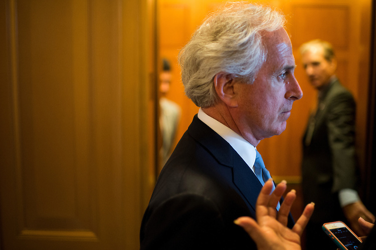 UNITED STATES - JUNE 10: Sen. Bob Corker, R-Tenn., speaks with a reporter as he leaves the Senate floor on Tuesday, June 10, 2014. (Photo By Bill Clark/CQ Roll Call)