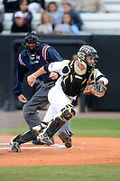 Central Florida Knights catcher Ryan Breen #9 during a game against the Siena Saints at Jay Bergman Field on February 16, 2013 in Orlando, Florida.  Siena defeated UCF 7-4.  (Mike Janes/Four Seam Images)