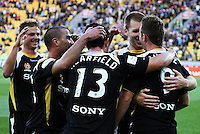 Phoenix players congratulate Shane Smeltz on scoring the home side's second goal during the A-League match between Wellington Phoenix and Newcastle Jets at Westpac Stadium, Wellington, New Zealand on Sunday, 4 January 2009. Photo: Dave Lintott / lintottphoto.co.nz