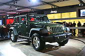 Green Jeep Rubicon on display at the Montreal auto show