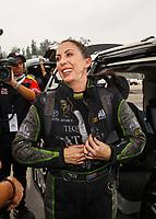 Nov 12, 2017; Pomona, CA, USA; NHRA funny car driver Alexis DeJoria reacts following the final race of her NHRA career during the Auto Club Finals at Auto Club Raceway at Pomona. Mandatory Credit: Mark J. Rebilas-USA TODAY Sports