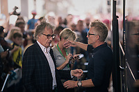 DS Brian Holm about to hug his pre-race guest Sir Paul Smith at the teambus<br /> <br /> Stage 8: London to London (77km)<br /> 15th Ovo Energy Tour of Britain 2018