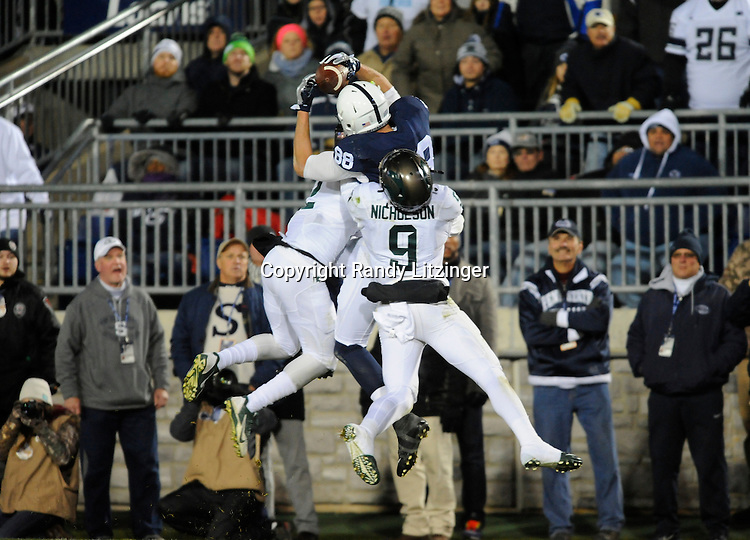 STATE COLLEGE, PA - NOVEMBER 26:  Penn State TE Mike Gesicki (88) leaps and catches a touchdown pass between Michigan State CB Darian Hicks (2) and S Montae Nicholson (9) during the third quarter. The Penn State Nittany Lions defeated the Michigan State Spartans 45-12 to win the Big Ten East Division on November 26, 2016 at Beaver Stadium in State College, PA. (Photo by Randy Litzinger/Icon Sportswire)