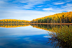 Fall colored hill reflecting on Nancy Lake, Nancy Lake State Recreation Area, Southcentral Alaska, Autumn.
