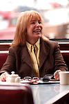 Pretty blond woman laughing in cafe
