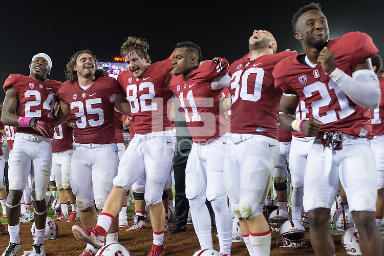 "Stanford, CA - October 15, 2015: Team celebrates during ""Hail, Stanford, Hail!\"" after the Stanford vs UCLA football game at Stanford Stadium. The Cardinal defeated the Bruins 56-35."