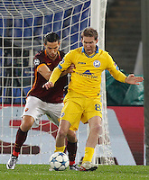 Calcio, Champions League: Gruppo E - Roma vs Bate Borisov. Roma, stadio Olimpico, 9 dicembre 2015.<br /> Bate Borisov's Aleksandr Hleb, right, is challenged by Roma's Kostas Manolas during the Champions League Group E football match between Roma and Bate Borisov at Rome's Olympic stadium, 9 December 2015.<br /> UPDATE IMAGES PRESS/Riccardo De Luca