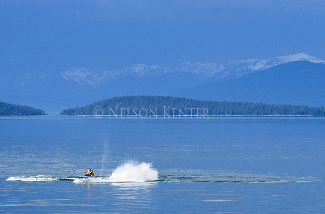 A jet ski rider making waves on Flathead Lake at Polson, Montana