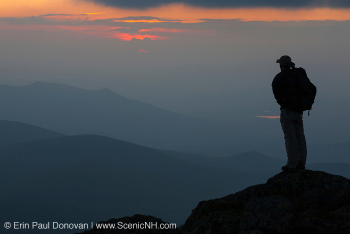 A hiker enjoys sunset from along the Gulfside Trail (Appalachian Trail), near the summit of Mount Clay, in Thompson and Meserve's Purchase, in the New Hampshire White Mountains. Mount Clay is named for Henry Clay, a 19th-century senator.