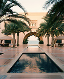 OMAN, Muscat, fountain pools at Barr Al Jissah Resort and Spa with sea in the background