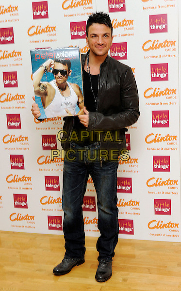 PETER ANDRE.signs copies of his new 2011 calendar at Clinton's Cards, Bluewater Shopping Centre, Kent, England, UK,.5th February 2011..full length jacket holding jeans necklace black leather.CAP/DH.©David Hitchens/Capital Pictures.