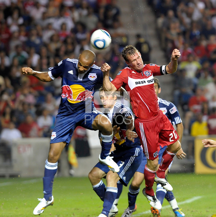 Chicago forward Brian McBride (20) battles for a header with New York forward Thierry Henry (14).  The Chicago Fire tied the New York Red Bulls 0-0 at Toyota Park in Bridgeview, IL on August 8, 2010