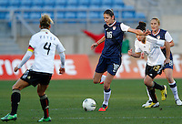 US's Yael Averbuch fights for the ball with Germany's Babett Peter and Celia Okoyino Da Mbabi during their Algarve Women's Cup soccer match at Algarve stadium in Faro, March 13, 2013.  .Paulo Cordeiro/ISI