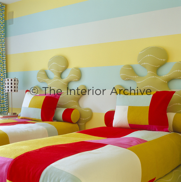 The children's bedroom is a riot of colour and pattern
