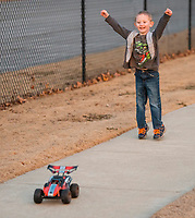 NWA Democrat-Gazette/BEN GOFF @NWABENGOFF<br /> Rylan Chandler, 4, of Bentonville chases a remote controll car driven by his brother Wednesday, Jan. 10, 2018, at Memorial Park in Bentonville. Chandler and his older brother received the cars for Christmas.