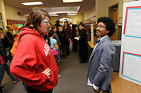 Note: Kirees is correct.<br /> STAFF PHOTO FLIP PUTTHOFF <br /> LIVING HISTORY <br /> Kira Martin, left, listens to Kirees Sampson play the role of Albert Einstein during a living history museum held Wednesday Dec. 17 2014 at Greer Lingle Middle School in Rogers. Sixth-grade students dressed as courageous figures from history after doing research on their characters, said Karie Harrison, a teacher at Lingle. Students recited a lesson about their characters for fifth-grade students from several Rogers elementary schools who toured the museum.