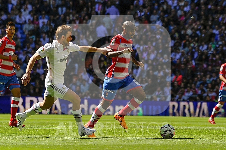 Real Madrid´s Asier Illarramendi and Granada´s Dimitri Foulquier during 2014-15 La Liga match between Real Madrid and Granada at Santiago Bernabeu stadium in Madrid, Spain. April 05, 2015. (ALTERPHOTOS/Luis Fernandez)