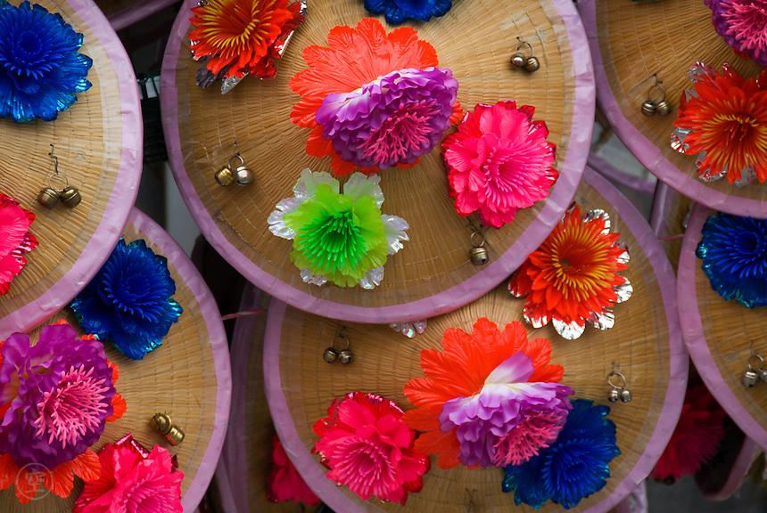 Straw hats adorned with colourful plastic flowers at the Nishitakanomachi Festival, Shimosuwa, Nagano, Japan, July 27 2008
