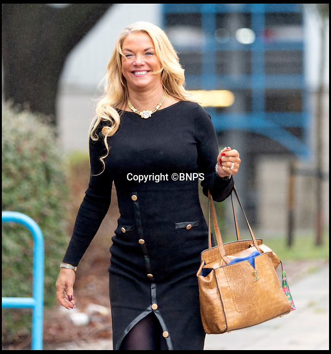 BNPS.co.uk (01202 558833)<br /> Pic: RogerArbon/BNPS<br /> <br /> Rebecca Vowles at Poole Magistrates Court yesterday.<br /> <br /> The ex-fiancee of a millionaire businessman denied started a cat fight with his new girlfriend - because she 'loved her nails too much'.<br /> <br /> Rebecca Vowles, 47, said she couldn't have banged down a locked toilet cubicle door to attack terrified love rival Samantha Newby-Vincent as it might have damaged her immaculate nails.<br /> <br /> But magistrates found the glamorous blonde defendant guilty of assault after being shown a video recording of the attack that happened in the ladies' loos at an exclusive marina in Poole, Dorset.
