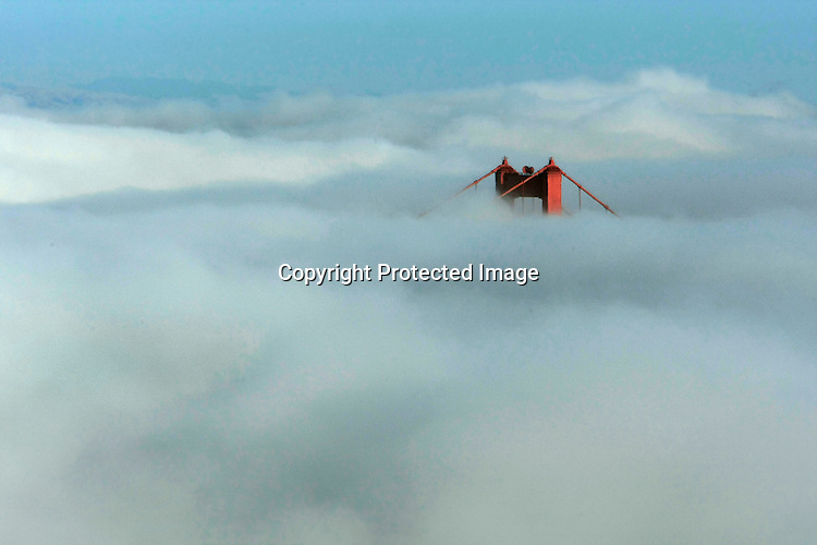 San Francisco summer fog top one of the towers of the Golden Gate Bridge in California.