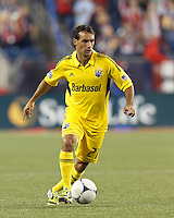 Columbus Crew defender Sebastian Miranda (21) brings the ball forward. In a Major League Soccer (MLS) match, the New England Revolution tied the Columbus Crew, 0-0, at Gillette Stadium on June 16, 2012.