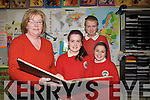Principal of Derryquay National School, Anne Dennehy, with sixth class pupils L-R Katie Twomey, Jordan Taylor and Victoria Keane looking at one of the first school role books as they make plans for the school's Centenary celebrations this year. .