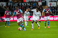 Aly Cissokho of Aston Villa  keeps the ball away from Bafetibi Gomis of Swansea City  during the Barclays Premier League match between Swansea City and Aston Villa played at the Liberty Stadium, Swansea  on March the 19th 2016