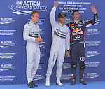 10.05.2014 Barcelona, Spain. F1 Spanish Grand Prix. Picture show Lewis Hamilton (GBR) and Nico Rosberg (GER) Mercedes AMG Petronas F1 Team and Daniel Ricciardo (AUS) Infiniti Red Bull Racing after finish qualifying at Circuit de Barcelona-Catalunya