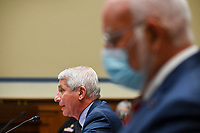 Anthony Fauci, director of the National Institute of Allergy and Infectious Diseases, speaks as Robert Redfield, director of the Centers for Disease Control and Prevention (CDC), right, listens during a House Select Subcommittee on the Coronavirus Crisis hearing in Washington, D.C., U.S., on Friday, July 31, 2020. Trump administration officials are set to defend the federal government's response to the coronavirus crisis at the hearing hosted by a House panel calling for a national plan to contain the virus. <br /> Credit: Erin Scott / Pool via CNP /MediaPunch