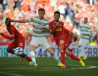 10th August 2013; Stuart Findlay, Glasgow Celtic, in action against Philippe Coutinho, Liverpool. Pre-season Friendly, Liverpool v Celtic, Dublin Decider, Aviva Stadium, Dublin. Picture credit: Tommy Grealy/actionshots.ie.