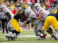 Ohio State Buckeyes offensive lineman Pat Elflein (65) and offensive lineman Jacoby Boren (50) against Michigan Wolverines at Michigan Stadium in Arbor, Michigan on November 28, 2015.  (Dispatch photo by Kyle Robertson)