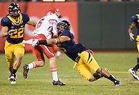October 22th, 2011:  Brendan Bigelow of California tackles Dres Anderson of Utah during a game at AT&T Park in San Francisco, Ca  - California defeated Utah  34 - 10