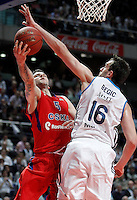 Real Madrid's Mirza Begic (r) and CSKA Moscow's Vladimir Micov during Euroleague 2012/2013 match.January 31,2013. (ALTERPHOTOS/Acero)