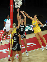 19.09.2013 Silver Ferns Irene Van Dyk and Australian Diamonds Bianca Chatfield in action during the Silver Ferns V Australian Diamonds New World Netball Series played at Vector Arena in Auckland. Mandatory Photo Credit ©Michael Bradley.